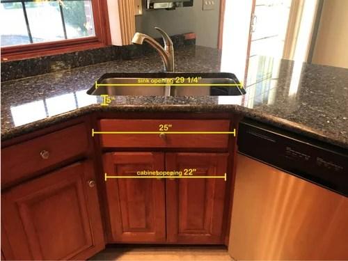 kitchen sink on a corner cabinet