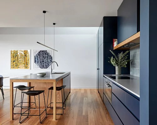 75 Modern Kitchen Design Ideas   Stylish Modern Kitchen Remodeling     Photo of a large modern galley eat in kitchen in Melbourne with a double