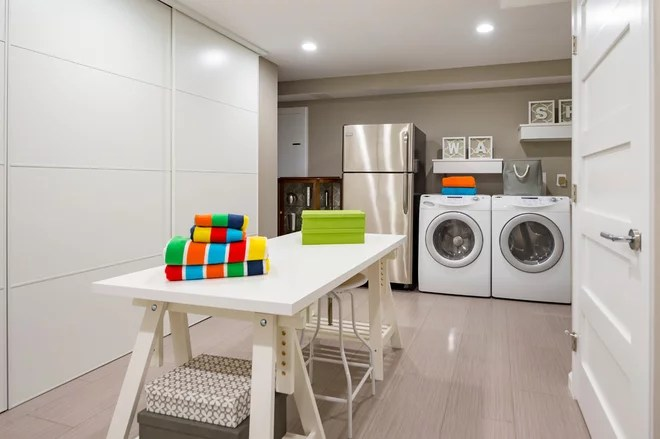 Contemporary Laundry Room by Synergy Design & Construction