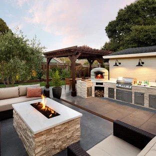 example of a mid sized classic side yard patio kitchen design in san francisco with