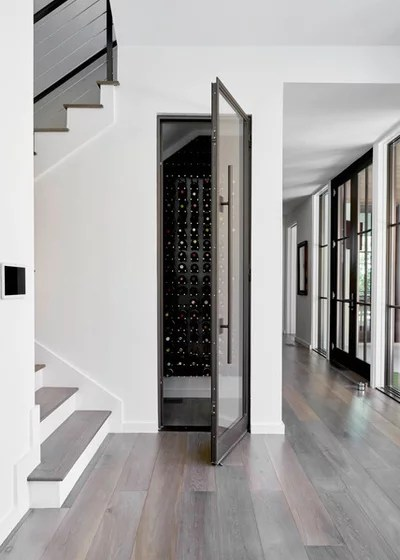 Contemporary Wine Cellar by Coats Homes