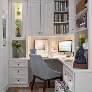 75 Most Popular Traditional Home Office Design Ideas for 2018     Example of a mid sized classic built in desk medium tone wood floor study