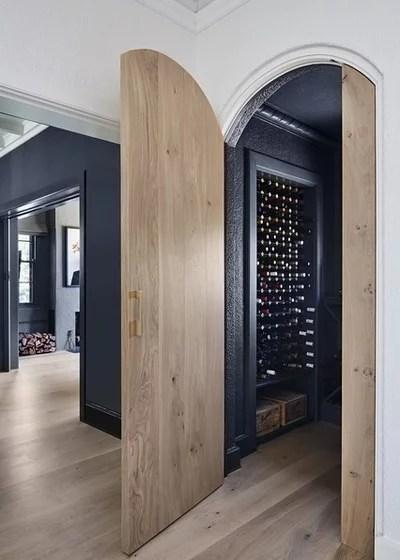 Contemporary Wine Cellar by Mirabuild