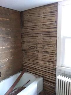old metal trim on vinyl bathtub surround