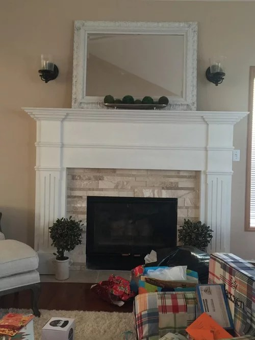 sconce lights over fireplace