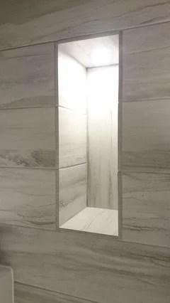 metal trim around tiled bathroom window