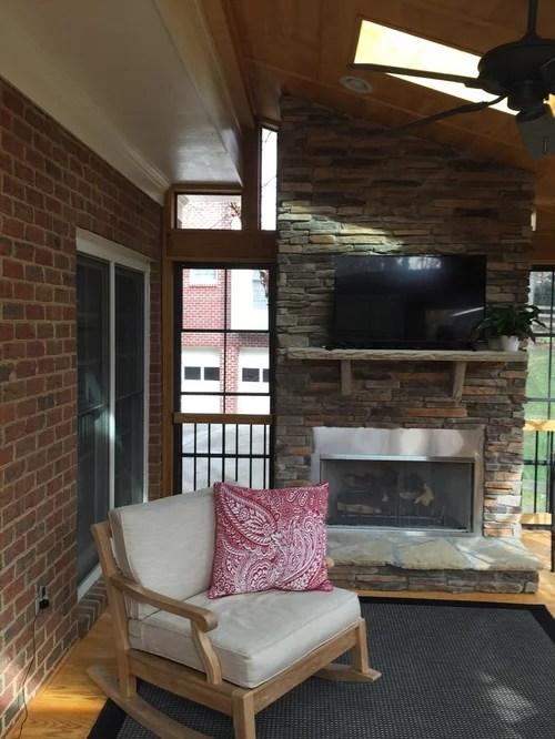 Cozy 3 Season Room With Stone Fireplace