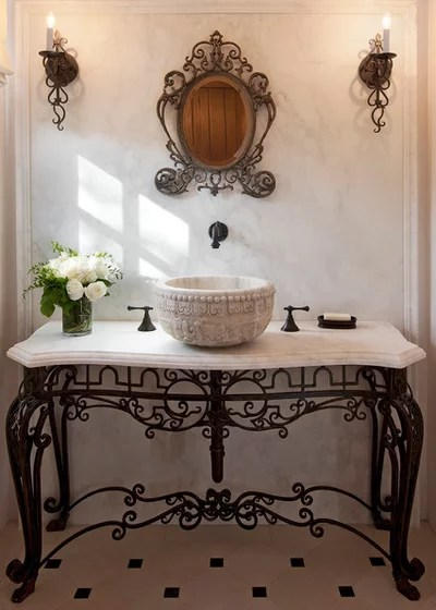 Mediterranean Powder Room by Studio 7 Architecture & Allied Arts