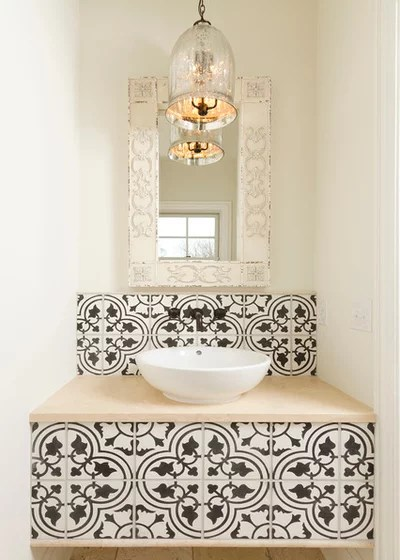 Mediterranean Powder Room by w.b. builders