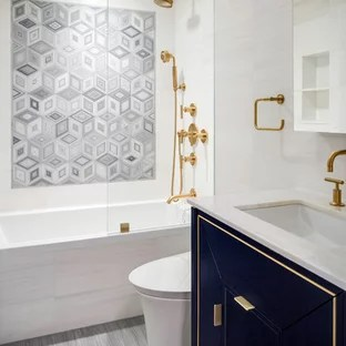 gray tile bathroom with beige walls
