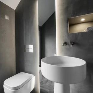modern powder room with a pedestal sink