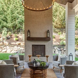 stamped concrete patio with a fireplace