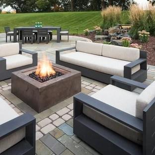 concrete paver patio with a fire pit