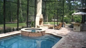 Tile replacement cut away coping to install 3 inch Flagstone Coping install stone face on raised beam and install Sheer Descent water featureclose off infloor cleaning system resurface pool with a Pebble Finish. Best 15 Swimming Pool Designers Installers In Jacksonville Fl Houzz