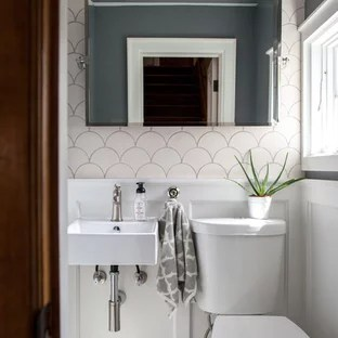 powder room with a wall mount sink