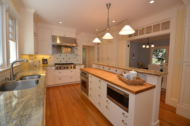 Kitchen With Split Level Island Traditional Kitchen
