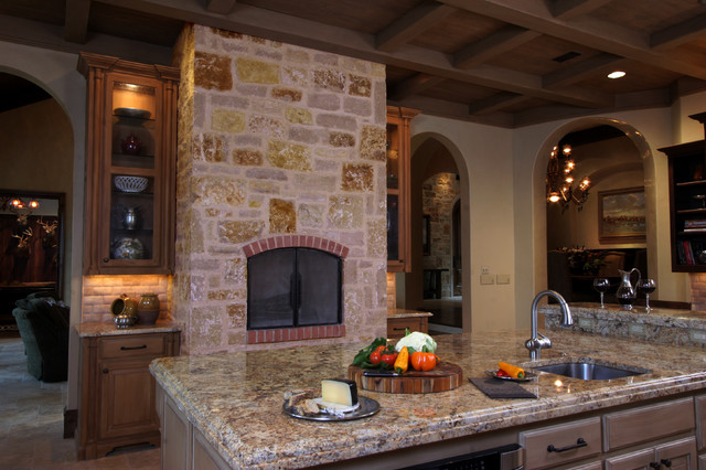 Natural Tuscan Inspired Kitchen View Of Fireplace