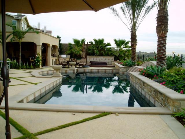 Modern Tuscan Dramatic Pool Outdoor Living Room