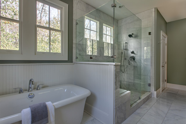 Classic White Marble Master Bath With Painted Beadboard