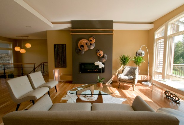 Color Theory Paint the Walls in the Living Room Earth Tones Fireplace Wall Art Indoor Plants Neutral Color Couches Accent Wall Floor Lamp