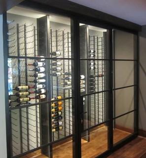 Glass Walls And Metal Custom Wine Racks Create A