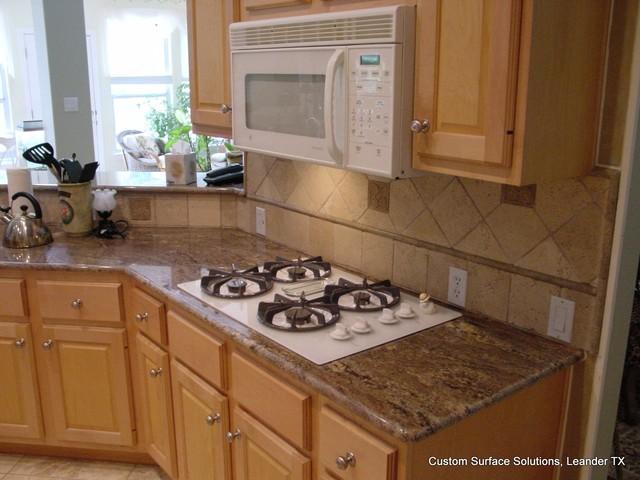 Granite Counter And Travertine Tile Backsplash