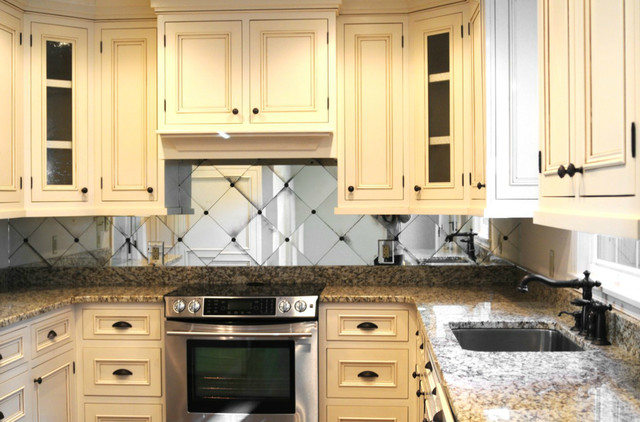 Traditional Kitchen With Cream Colored Cabinets And Mirror