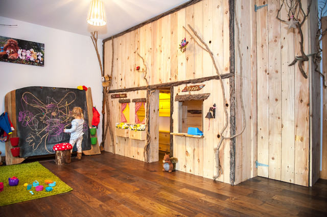 Indoor forest cottage playroom with giant blackboard and rustic storage rustic-kids