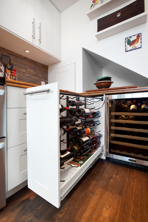 a custom wine rack drawer is one way to give your cabinets a designer touch and house a growing wine collection