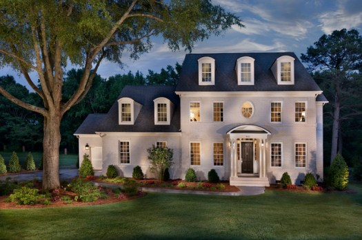 Example Of A Large Classic White Three Story Brick Exterior Home Design In Charlotte