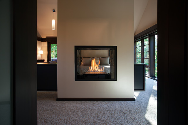 Double Sided Fireplace In Master Suite