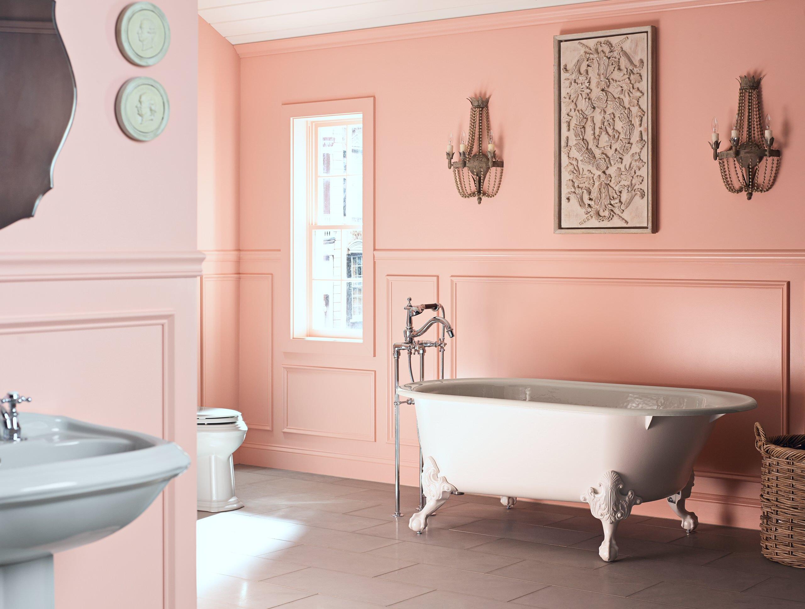 pink bathroom with a pedestal sink
