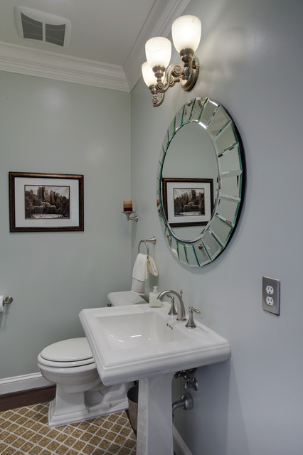 pedestal sink with a fitting mirror