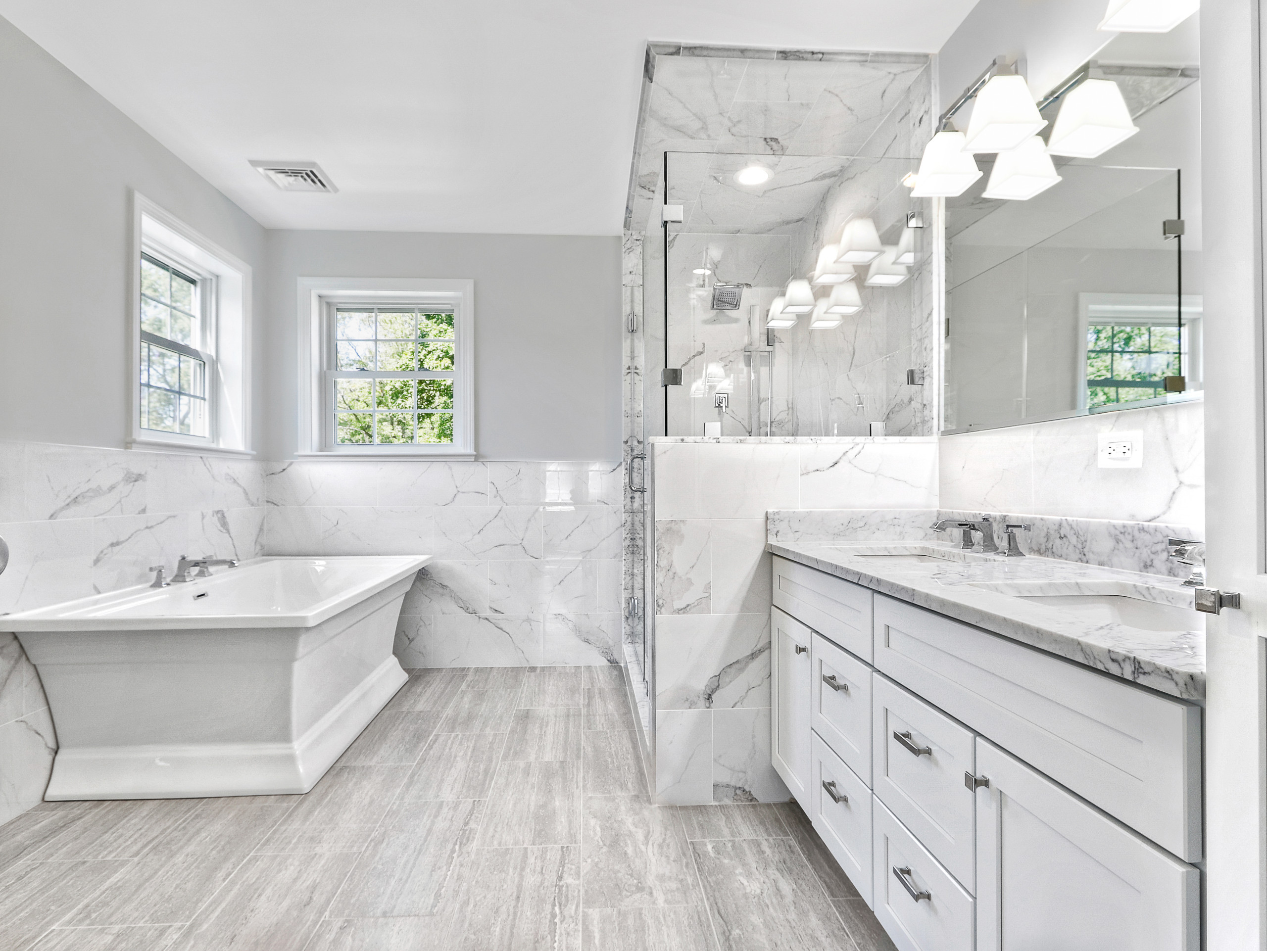bathroom with gray countertops