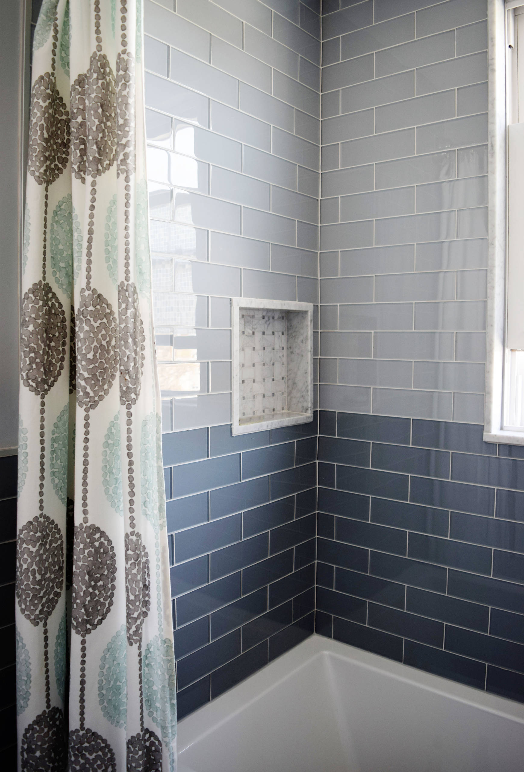 sea glass tile shower located in