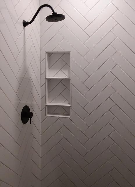 white herringbone shower tile