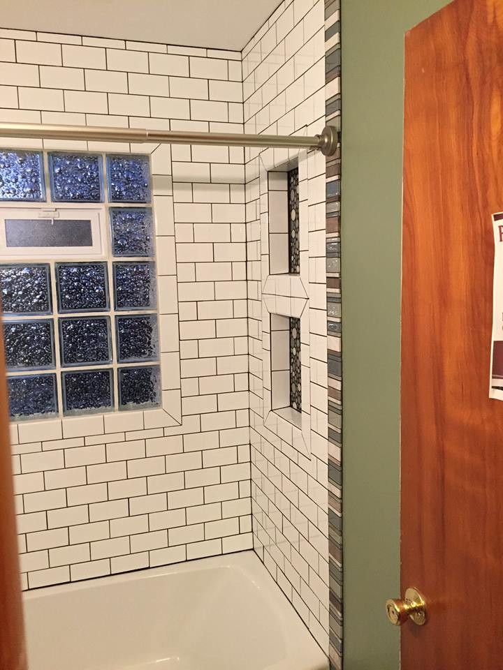 white subway tile shower with glass