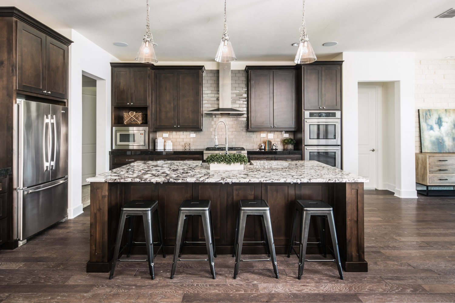 with brown cabinets and gray backsplash