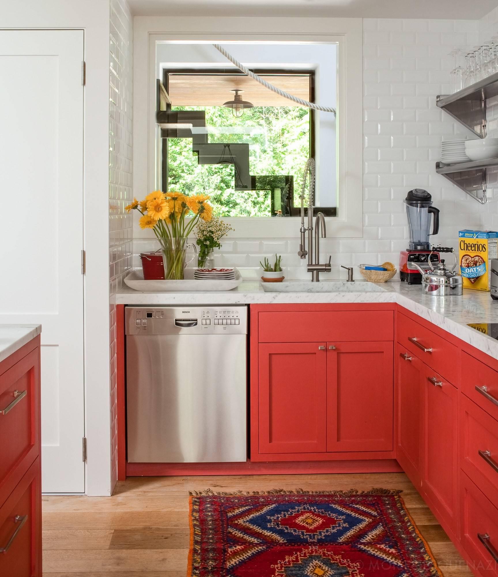 red cabinets and subway tile backsplash