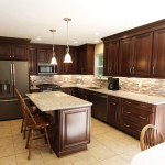 Waypoint Cherry Chocolate Cabinets And Giallo Ornamental Granite Countertops Traditional Kitchen Cleveland By Cabinet S Top