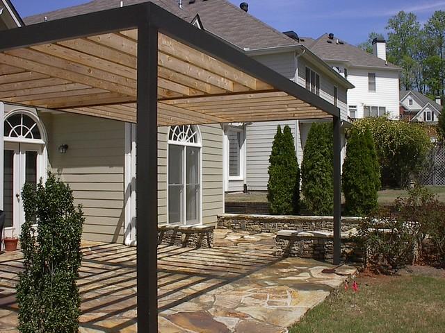 contemporary pergola over stone patio