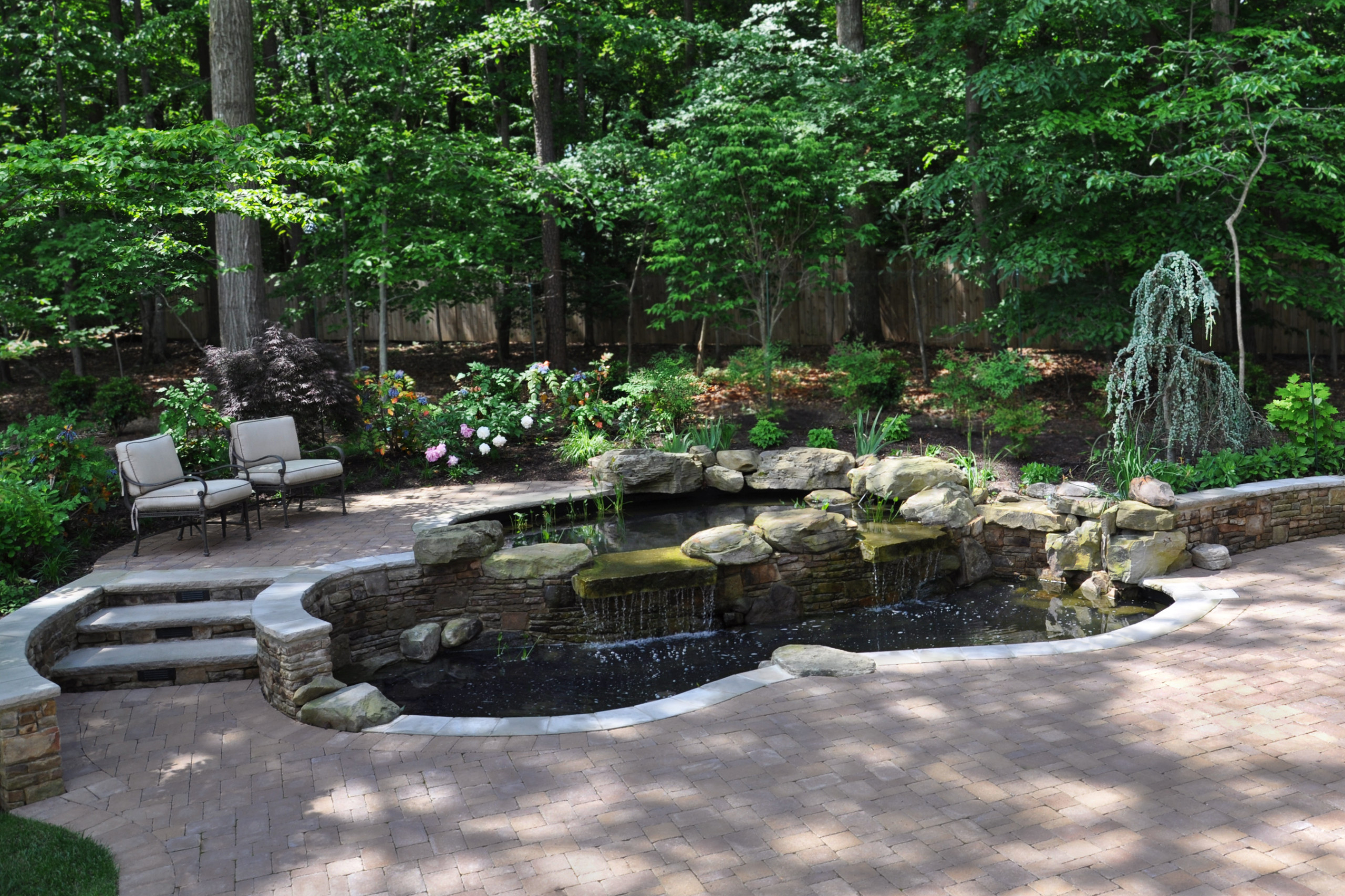 two tiered koi pond and paver patio