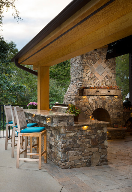 outdoor fireplace with grill island and