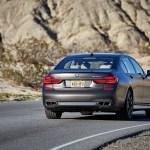 2017 BMW M760i xDrive rear three quarter in motion 07