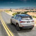 2017 Jeep Compass Limited rear three quarter in motion 03