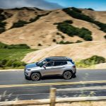 2017 Jeep Compass Limited side in motion 03