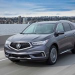2017 Acura MDX Hybrid front three quarter in motion 10