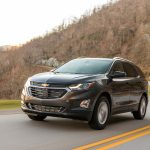 2018 Chevrolet Equinox front three quarter in motion 12