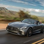 2018 Mercedes AMG GT C Roadster front three quarter in motion 14