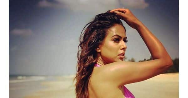Nia Sharma looks stunning in a pink swimsuit